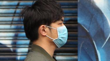 A man wears a face mask in Melbourne's CBD.