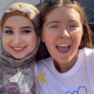 Ruqia Haidari, left, and Abbey Gawne, right,  during their graduation atMcGuire College in Shepparton.
