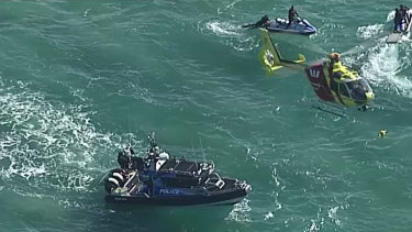 Helicopters, boats and jet skis scour the water off Stradbroke Island after several pieces of debris were found.