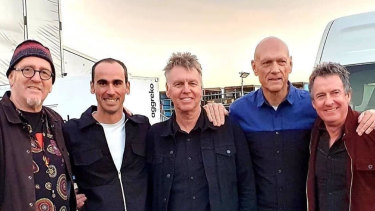 Refugee Mostafa 'Moz' Azimitabar, second from left, with Midnight Oil members Jim Moginie,Martin Rotsey, Peter Garrett and Rob Hirst.