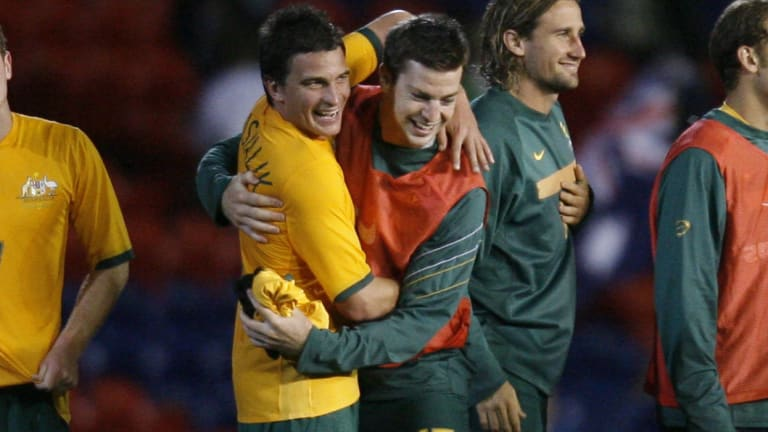 Mudgee's favourite son: Aaron Downes (right) celebrates with Stuart Musialik after a win by the Olyroos over North Korea in 2007.