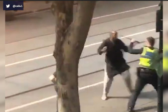 Bourke Street attacker Hassan Khalif Shire Ali confronts police in the moments before he is shot on November 9, 2018.