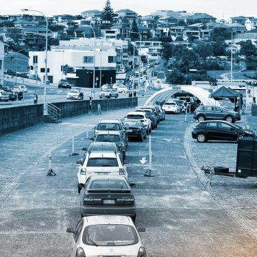 Cars queue for drive-through COVID-19 testing at Bondi Beach on May 13.