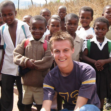 Evans in 2003 in Embo, a rural township near Durban, South Africa, where he spent his gap year overseeing development projects.