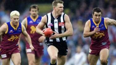Nathan Buckley in action in the 2002 Grand Final.