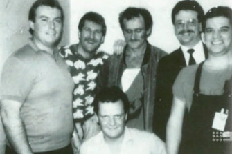 The ultimate trophy photo: armed robbery detectives, including Ken Ashworth on the left, with a captive Russell Cox.