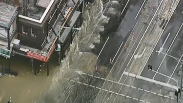 A burst water main on Victoria Street on the edge of the Melbourne CBD has turned the street into a river.