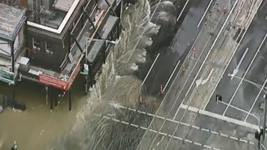 Traffic chaos as burst water main sends water gushing down CBD street