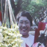 A woman pays tribute to a teacher who killed in Sunday's protests in Yangon, Myanmar.