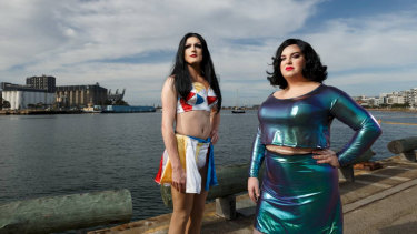 Drag performers Jessica, left, and Nova in Newcastle on Sunday. Jessica is wearing the outfit Finnegan's Hotel deemed did not meet its dress code for men or women.