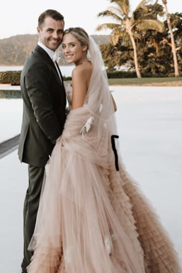 Deborah Symond in her $200,000 Christian Couture wedding gown with Ned O'Neil on their wedding day at Qualia.