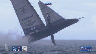US boat American Magic capsizing during a Prada Cup race.