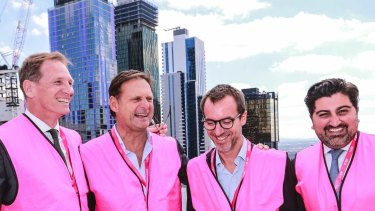 Scape co-founder Craig Carracher (far left) during construction at one of the company's Melbourne properties.