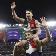 Aaron Sandilands and Hayden Ballantyne are clapped off the field after their last game in front of the Fremantle Dockers faithful at Optus Stadium.