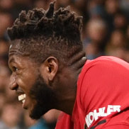 Fred of Manchester United reacts after being hit by a lighter thrown from the crowd at Etihad Stadium.