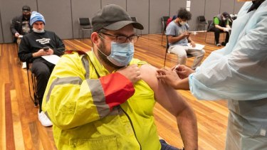 Warehouse worker Daniel Matcham gets his vaccine in Hoppers Crossing last month.