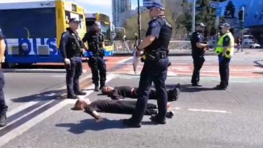 Brisbane bridge closes after protesters glue themselves to road