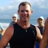 Fears for triathlete who slipped from jet ski at Sunshine Coast