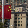 China plays down contagion fears as clock ticks on Evergrande