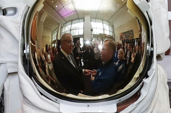 Prime Minister Scott Morrison, Australian astronaut Andy Thomas and astronaut Pam Melroy after the signing of a letter of intent on expanding cooperation in space exploration, at the NASA headquarters in Washington DC.