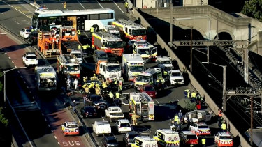 Emergency services on the Sydney Harbour Bridge on Thursday morning following a serious crash.