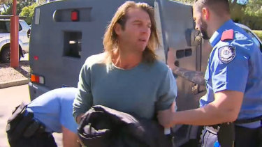 Fallen Eagles star Ben Cousins after being arrested in Victoria Park.