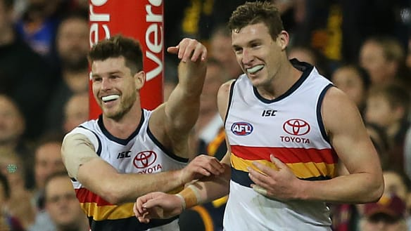Crows scrape home over Lions