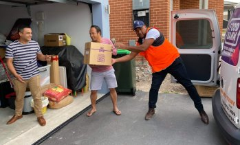 Amit Thapa (right), founderof the Friends of Nepal Association,gives a helping hand.