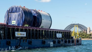 Parts of Kathleen are barged to Barangaroo where she will be assembled before she starts digging two kilometre-long tunnels under Sydney Harbour.