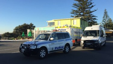 Police at Newcastle's Stockton Beach after the body of an elderly man was found.