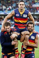 Andrew McLeod, pictured being chaired off the ground after his 300th game, now feels he's not welcome.