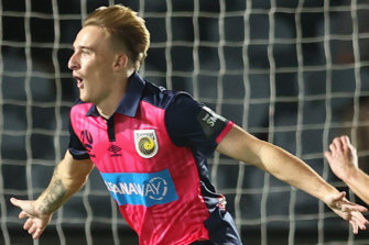 Matthew Hatch celebrates his goal - the fastest debut goal in A-League history - on Monday night.
