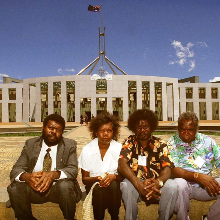 The son of Eddie Mabo, Eddie Mobo jnr.(left) with Wik people from Cape York Peninsula Norma Chevathun (2nd left) Jonathan Korkaktain (2 right) and Doug Woolah (far right).