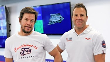 F45 owner Rob Deutsch, right, with actor Mark Wahlberg, who bought a minority stake in the company in 2019.