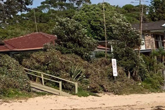 The Stricker-Phelps Bundeena abode with sign.