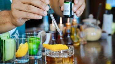 A bartender prepares a CBD infused Stoney Negroni at Adriaen Block, a bar and restaurant in Queens