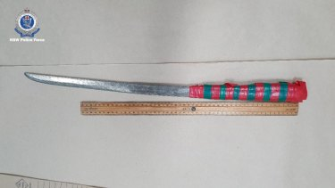 A samurai sword was among the items police seized in the search of the two homes.