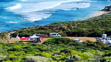 Ambulances arrive at the South West surf break last week after the first shark attack of the day.