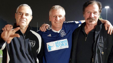 DrJohn Galicek (centre) with the two soccer players he revived after heart attacks, Nick Schicht (left) and Ian Rae.