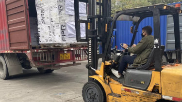 Pictures from the WeChat account of Chinese state-owned property developer Poly Australia, which sent medical supplies to China in January and February this year.