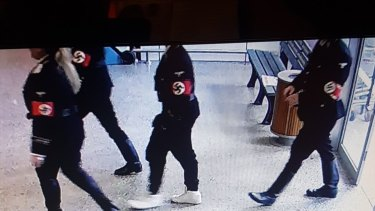 A photo from inside the Coles supermarket at Woodend shows four people entering the store in Nazi regalia.