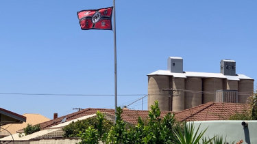 Several neighbours complained to police about the flag.