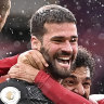Liverpool's goalkeeper Alisson Becker celebrates after scoring the winning goal.