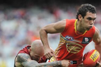 Harley Bennell, right, in action for the Suns.
