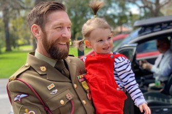 Dusty Miller and his daughter, Eliza. Dusty has had trouble shaking the memory of events in Afghanistan.