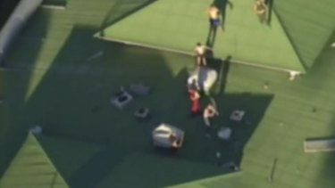 The shirtless youths on the roof of the Brisbane Youth Detention Centre.