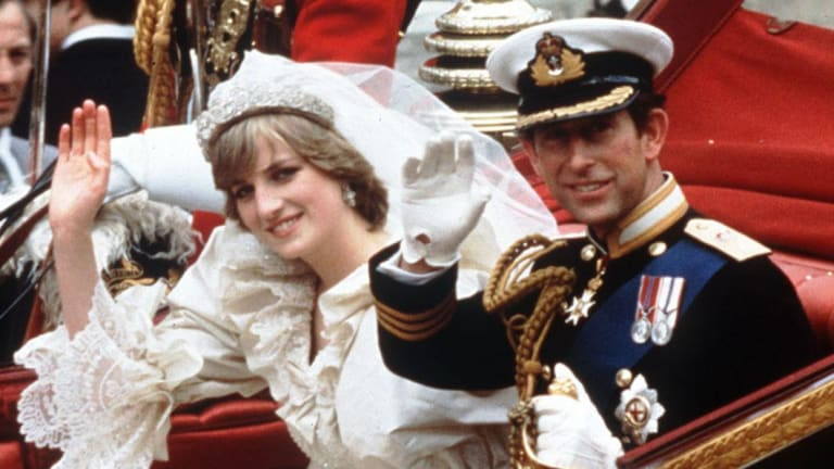 The Princess and Prince of Wales wave from their carriage on their wedding day in 1989.