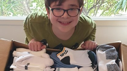 11-year-old boy sends socks to residents of storm-hit Dandenong Ranges