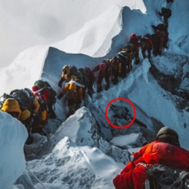 Everest climbers pass a dead body (circled) in May.