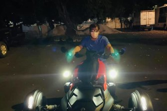 Rodrigo Duterte is shown riding a motorcyclelate at night within the presidential compound in Manila on Sunday.